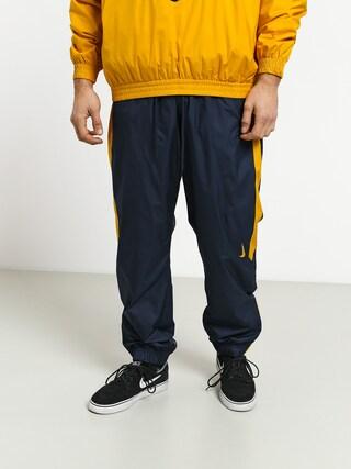 Kalhoty Nike SB Shield Trck Pnt Swoosh (obsidian/dark sulfur/dark sulfur)